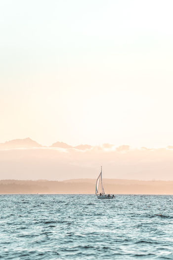 Beauty In Nature Copy Space Horizon Over Water Idyllic Mountain Nature Nautical Vessel No People Non-urban Scene Outdoors Sailboat Scenics - Nature Sea Silhouette Sky Sun Sunset Tranquil Scene Tranquility Transportation Water Waterfront