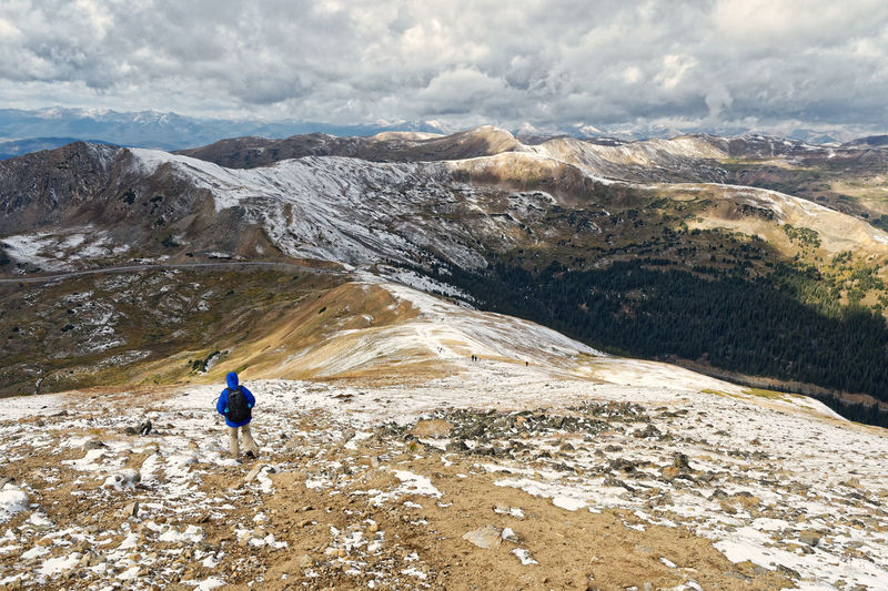 Hiking in late summer snow at 13,000 feet. Adventurous Alpine Lost In The Landscape Adventure Beauty In Nature Challenging Cloud - Sky Day Hiking Lifestyles Mountain Mountain Range Nature Outdoors People Real People Scenics Snow Walking