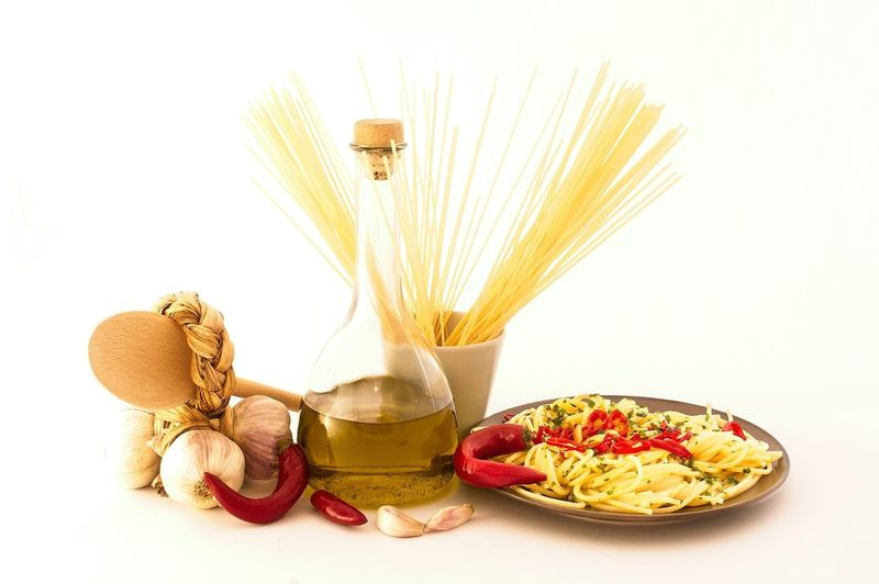 Plate of spaghetti with garlic, olive oil, chili pepper on white background Food And Drink Food Freshness Pasta Indoors  Wellbeing Still Life White Background Studio Shot Italian Food Spaghetti Healthy Eating No People Ingredient Cut Out Table Close-up Plant Flower Cooking Oil Snack Olive Oil Hot Pepper Garlic