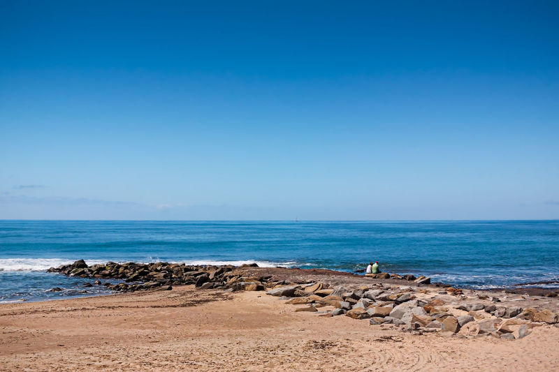 Sitting On The Jetty Arid Climate Australia Beach Caloundra Coastline Composition Horizon Over Water Love Ocean Outdoors Perspective Queensland Remote Sand Scenics Sea Seascape Shore Summer Surf Tranquil Scene Tropical Climate Vacations Water Wave