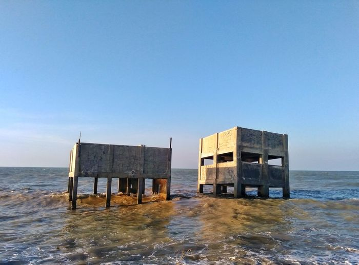 Hut Sea Built Structure Beach Water Outdoors Building Exterior Architecture Stilt House Day No People Sky Horizon Over Water Nature Business Finance And Industry