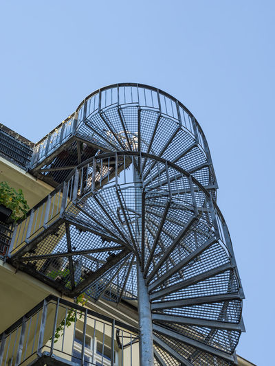Berlin Stairs Stairway Architecture Balcony Blue Building Building Exterior Built Structure Circular Stairway Clear Sky Copy Space Day Low Angle View Metal Modern Nature No People Outdoors Pattern Sky Staircase Sunlight Tall - High