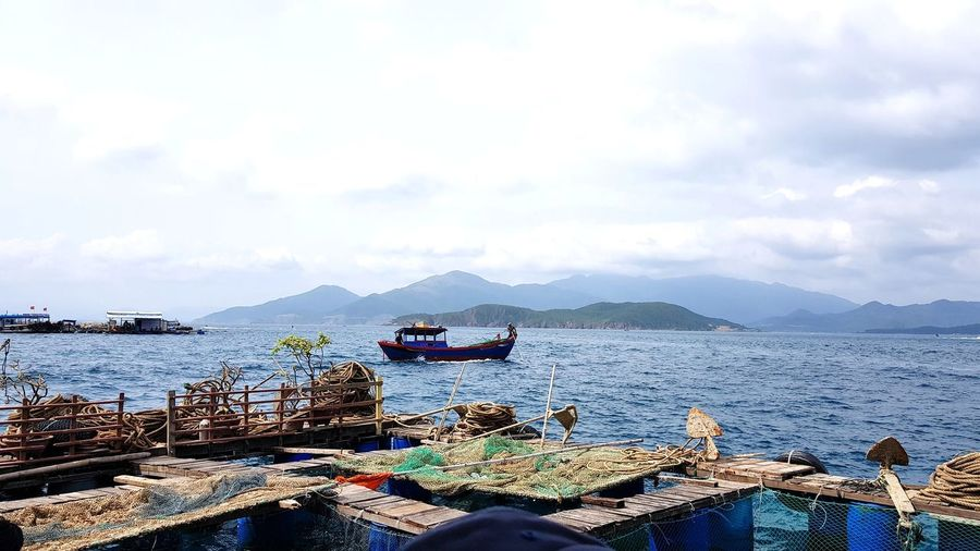 seafood and fish farm, South Coast of Vietnam Travel Trip Outdoors Daily Life ASIA Vietnam #nhatrang Seafood Crabfarming #picoftheday Water Sea Nautical Vessel Mountain Beach Sky Cloud - Sky Boat Dock Calm Commercial Fishing Net Fishing Net Fishing Industry Ocean Countryside Shore Harbor Water Vehicle Fishing Equipment