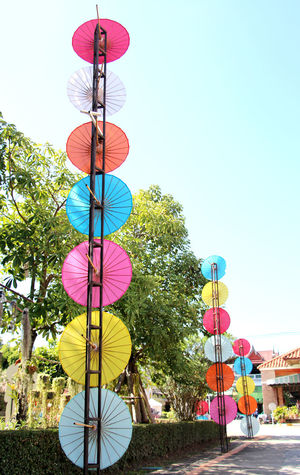 Colorful umbrellas are indigenous handicrafts in Thailand. Thai Thailand Travel Summer Holiday Health Healthcare Lifestyle Lifestyle People Handmade Handicraft Craft Art Art And Craft Indigenous  Light And Shadow Colorful Relax Recreation  Umbrella Clear Sky Multi Colored Road Sign City Tree Sky Colored Pencil Street Art Male Likeness Graffiti