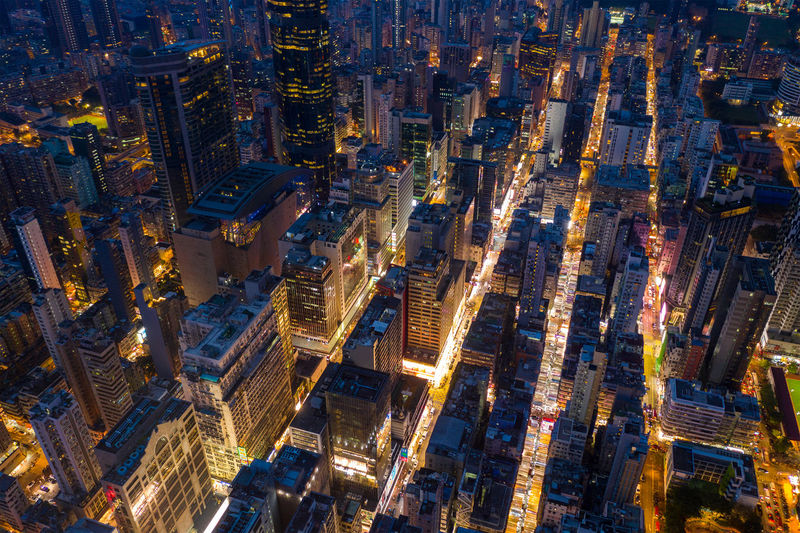Aerial view of buildings in city at night