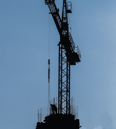 17.62° Sky Machinery Low Angle View Industry Architecture Crane - Construction Machinery Construction Site Construction Industry Development No People Nature Built Structure Metal Clear Sky Tall - High Outdoors Copy Space Day Silhouette Blue Construction Equipment Industrial Equipment The Architect - 2019 EyeEm Awards