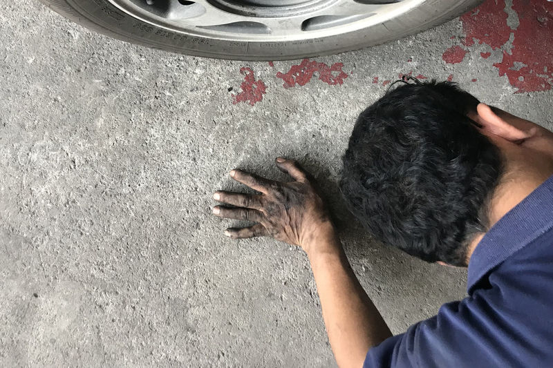 Mechanic laying behind car and looking under car to resolve problem One Person Real People Men High Angle View One Animal Headshot Lifestyles Vertebrate Domestic Animals Domestic Pets Casual Clothing Leisure Activity Portrait Human Body Part Rear View Mammal Pet Owner Mechanic Looking At Camera Under Car Fixie Resolve Car Dirty