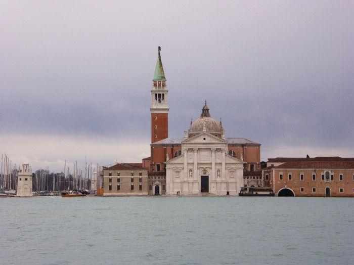 Church of san giorgio maggiore by grand canal against cloudy sky
