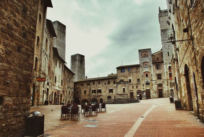 San Gimignano MedievalTown Unesco World Heritage Historical Center Medieval Architecture Tuscany Italy Bella Italia City Square Empty Seeing The Sights Urban Geometry Stone Stone Patterns Brick Pattern Towers Restaurant Pastel Power Pastel Shades