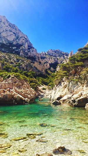 Calanques de sugiton, Marseille 😍 Rock - Object Mountain Nature Rock Formation Landscape Water Scenics Geology Beauty In Nature Outdoors Tranquility Blue Tranquil Scene No People Day River Physical Geography Clear Sky Travel Destinations Sky