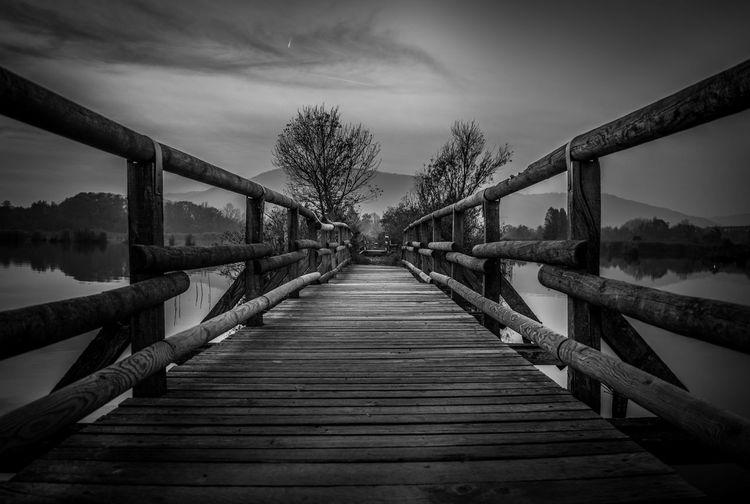 Bridge over footbridge against sky