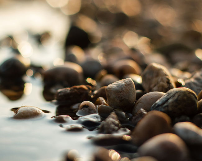 High angle view of pebble stones at beach