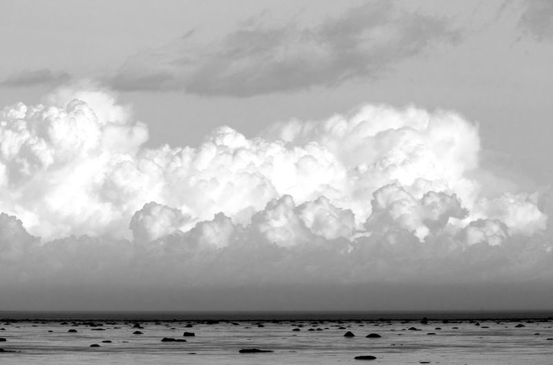 Big white clouds and a blue sky Cloud - Sky Sky Water Sea Horizon Scenics - Nature Nature Beauty In Nature Horizon Over Water Land Environment Tranquility Storm Beach No People Tranquil Scene Overcast Day Outdoors Ominous Power In Nature Blackandwhite Black And White Photography