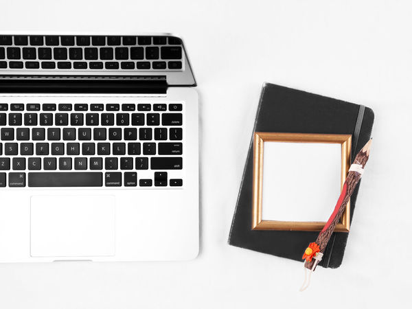 Flat lay of a workspace. Laptop and note book on a white desk. Apply Blank Communication Computer Computer Keyboard Copy Space Desk Desk Employee Employer  Flat Lay Focus Home Office Intern Internship Job Job Application Laptop No People Table Technology White Background Work Workspace