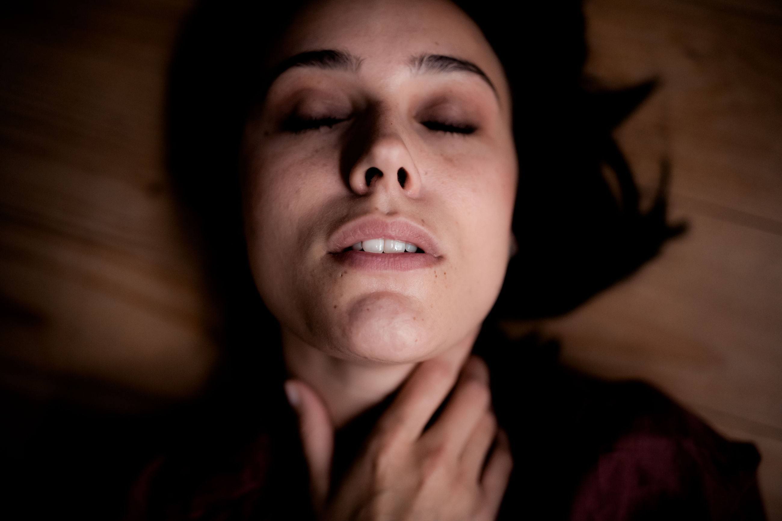 headshot, one person, portrait, front view, indoors, real people, young adult, lifestyles, close-up, young women, leisure activity, lying down, lying on back, women, focus on foreground, smiling, looking, human body part, contemplation, human face