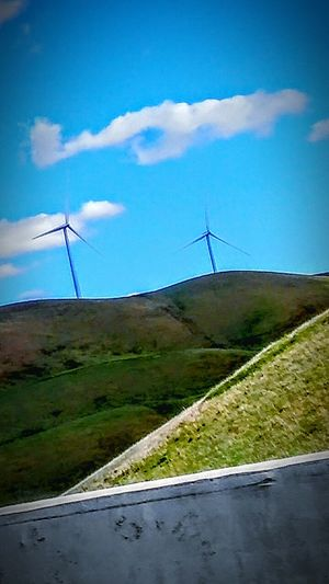 Taking Photos Check This Out Clouds And Sky Cloud Porn Wind Turbines Wind Turbines On A Field Wind Power Environmental Conservation Telling Stories Differently Green Hillside My Point Of View This Week On Eyeem Driving Highway 580 Road Side View Drive By Photography Freeway Scenery Green Blue Sky