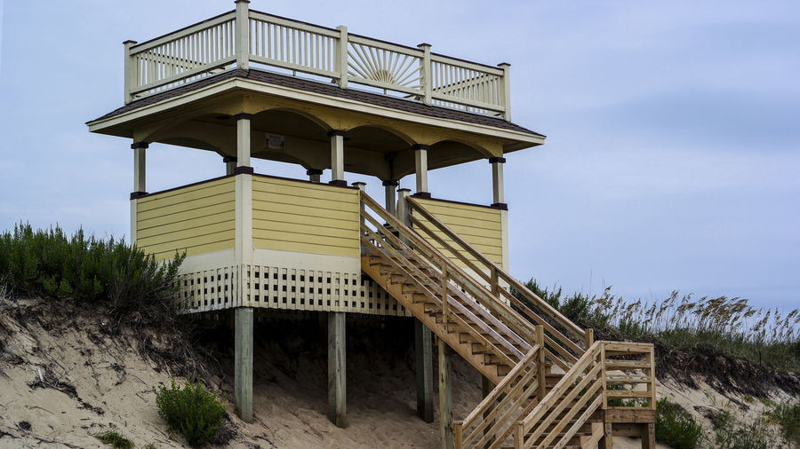 Marcweberde Architecture Built Structure Sky Nature Day Land Staircase No People Low Angle View Cloud - Sky Plant Building Exterior Beach Wood - Material Outdoors Railing Tree Lifeguard Hut Hut Non-urban Scene