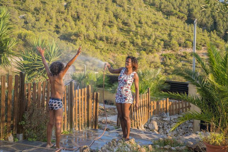 Women standing by plants