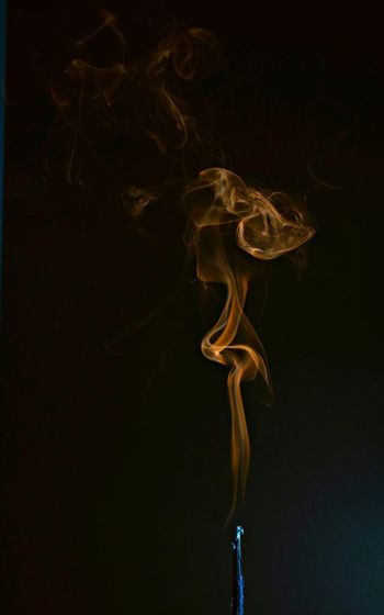 Orange smoke. Image of insnese smoke. Studio Shot Black Background No People Swirl Smoke - Physical Structure Close-up Incense Outdoors First Eyeem Photo Orangesmoke Art Art Photography Photographer Photooftheday Photo Photography Highflash Smoke Black Background Orange