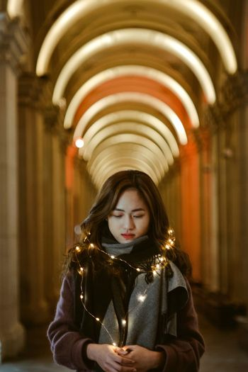 Indoors  One Person Illuminated Front View Focus On Foreground Architecture Women Lifestyles Real People Portrait Young Adult