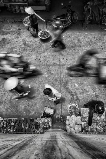 High angle view of man standing on street market in city