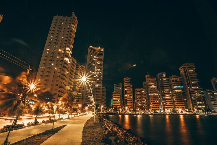 Cartagena Nights EyeEm Best Edits Long Exposure Illuminated Night Architecture Built Structure Building Exterior City Nature Building No People Skyscraper Lighting Equipment Modern Cityscape Outdoors Light