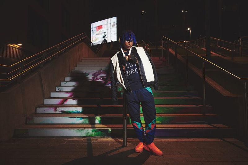 Man walking on staircase at night
