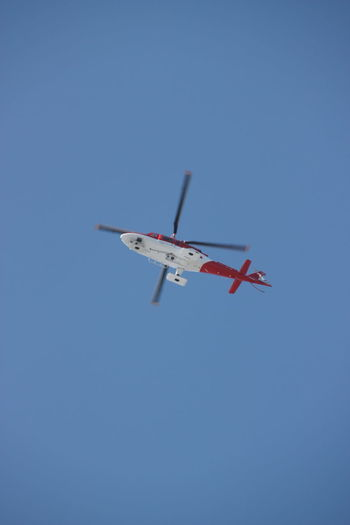 Emergency Helicopter Rotor Standing Above Your Head Aerospace Industry Air Vehicle Blue Clear Sky Day Flying Low Angle View Mid-air No People Outdoors Sky Transportation