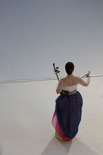 Artist Haegeum Korea Korean Stage Arts Culture And Entertainment Full Length Hanbok Korea Traditional Dress Lifestyles Low Angle View Music One Person Outdoors People Real People Rear View Standing