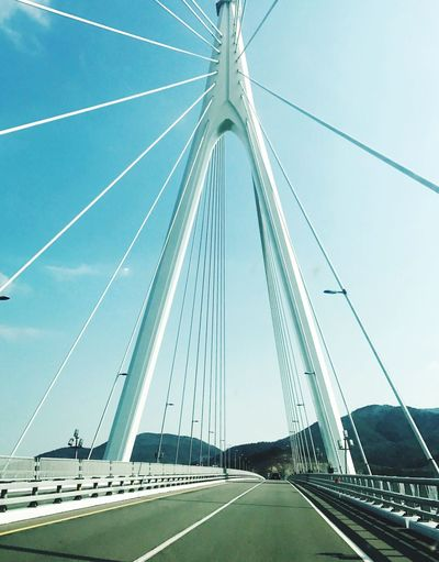 Connection Bridge - Man Made Structure Transportation Road The Way Forward Engineering Sky Outdoors Day Suspension Bridge Cable Built Structure Architecture Bridge No People Steel Cable LINE