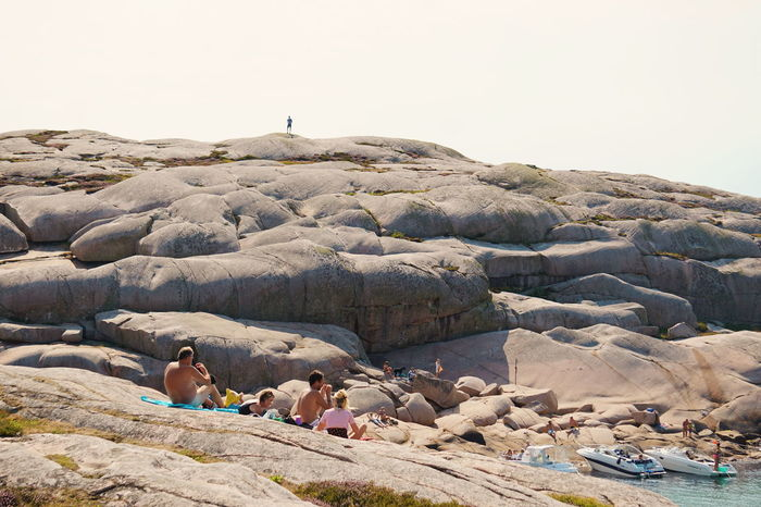 people enjoying the summer on the marble rocks of Hållö Rock Cliff Summer People EyeEm Selects Sea Beach Water Clear Sky Arid Climate Nature Reserve Geology Rock Formation Natural Landmark Rocky Mountains Physical Geography
