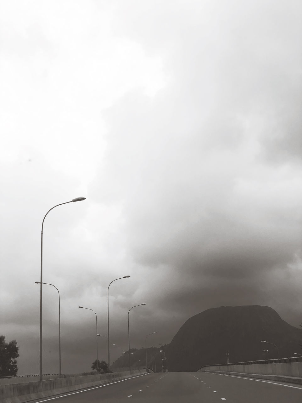 STREET LIGHTS AGAINST SKY