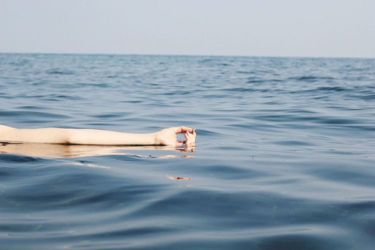 Low section of person in sea
