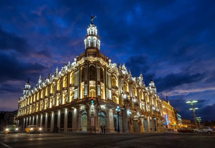 Illuminated National Theater Of Cuba By Road Against Sky At Night