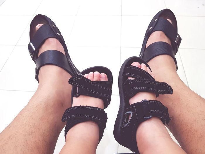 Human Leg Limb Black Color Low Section Human Body Part Adult Human Foot People Adults Only Shoe Young Adult Young Women Indoors  Only Women One Person Lifestyles Close-up One Young Woman Only One Woman Only Day Fatherhood Moments Father & Son Footware Pairs Terno