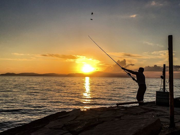 Turkey Mediterranean Sea Sunset Silhouettes Feelings Motion Idyllic Sunset Fishing Sea Fishing Rod Water Fishing Pole Nature One Person Silhouette Beauty In Nature Scenics Weekend Activities Fishing Tackle Leisure Activity Sky Tranquil Scene Standing Capture Tomorrow
