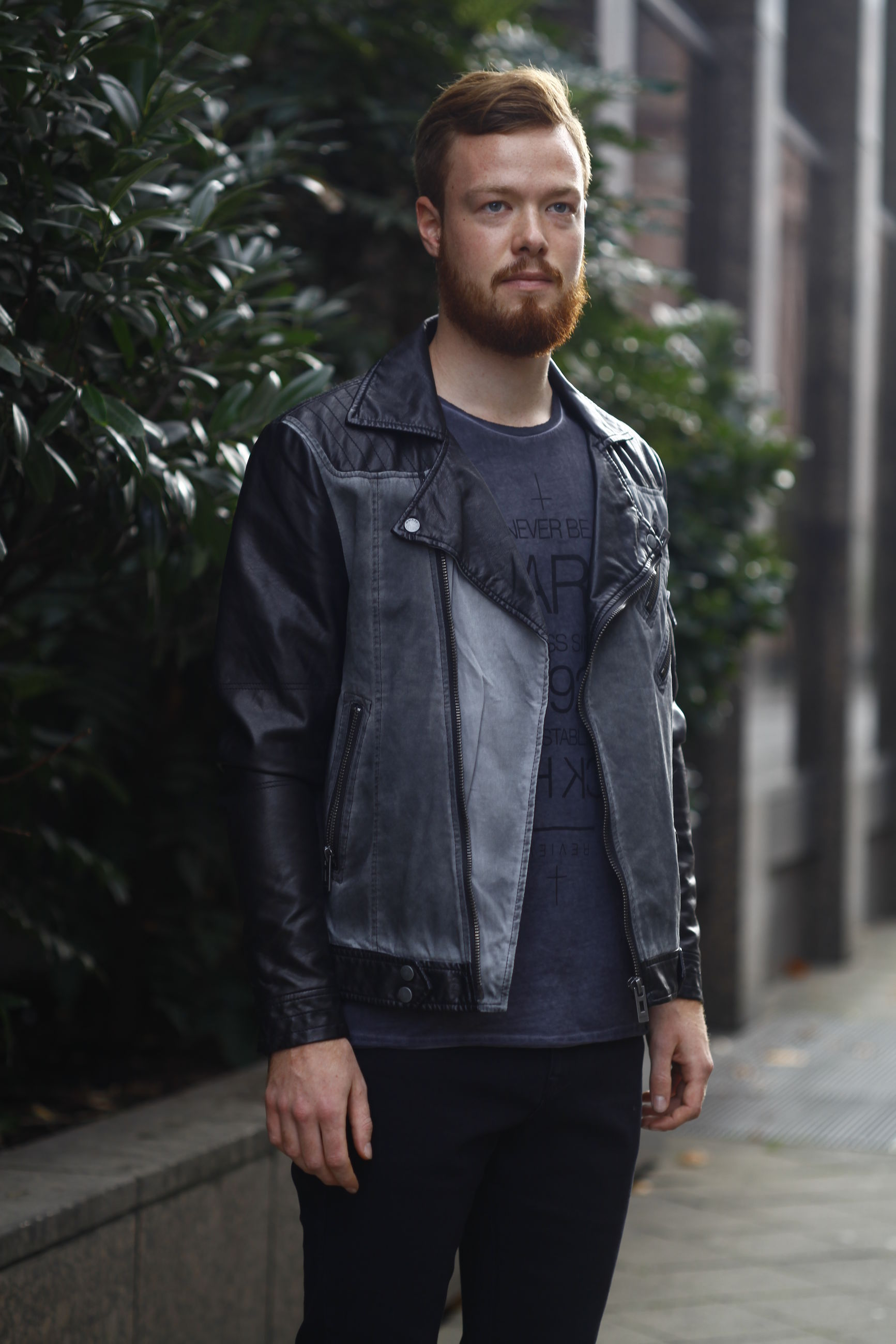 casual clothing, front view, looking at camera, portrait, person, lifestyles, young adult, standing, young men, leisure activity, focus on foreground, jacket, three quarter length, warm clothing, waist up, smiling, handsome