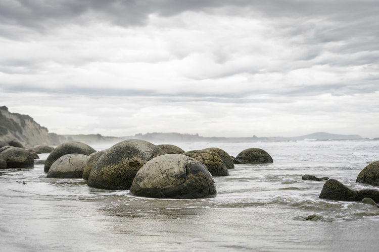 Sky Water Cloud - Sky Beauty In Nature Rock Scenics - Nature Sea Waterfront Rock - Object Nature Tranquil Scene Tranquility Solid Land No People Day Beach Idyllic Outdoors