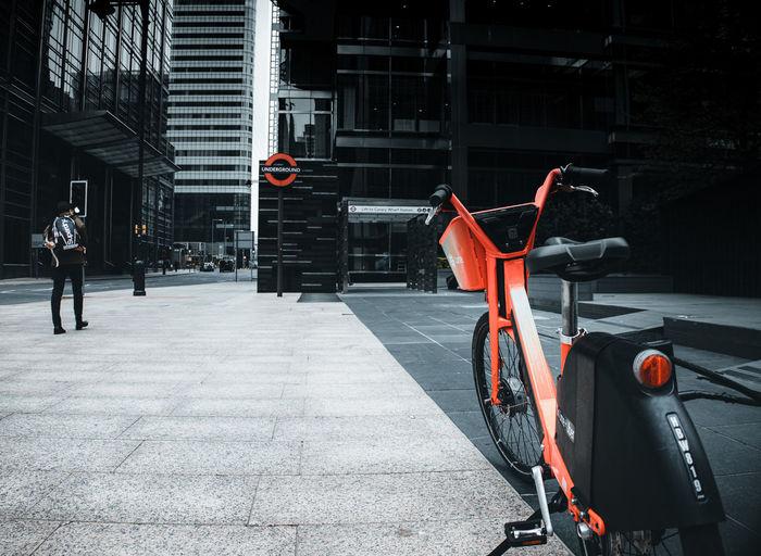 Bicycle on street against buildings in city
