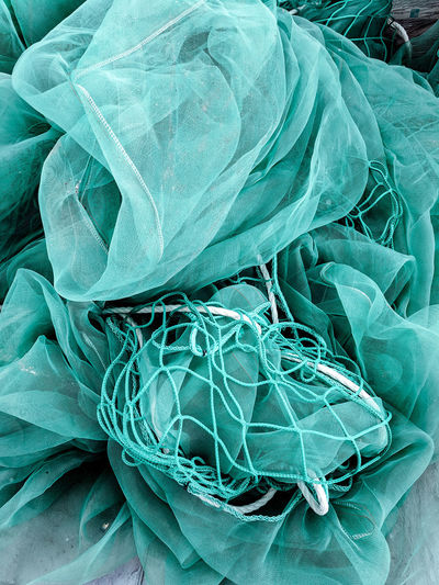 sacks and nets Net Construction Site Netting Sackcloth Sack Turquoise Colored Building Site Backgrounds Textile Close-up Netting Rag Textured  Fabric Full Frame Pattern Rough Cloth