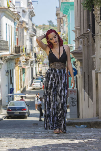 walking around Havana Cuba Old Havana Street Scene Street Shot Streetphotography Red Red Hair Dyed Hair Walking Arms Raised Eyes