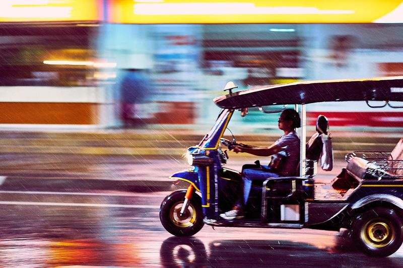 TukTuk in the Rain Chiang Mai | Thailand TukTuk Blurred Motion On The Move Transportation Mode Of Transport Land Vehicle Motion Speed Travel Road Driving Rain Street Streetphotography Rush Hour SONY A7ii City Life Colorful Colour Of Life Determination