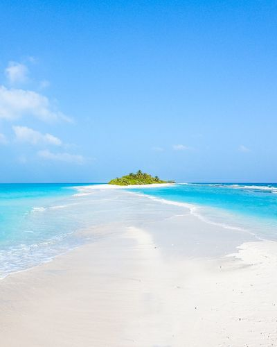 Island Sea Beach Land Water Sky Scenics - Nature Beauty In Nature Blue Tranquility Horizon Over Water Tranquil Scene Nature Horizon Idyllic Sand Cloud - Sky Day No People Travel Destinations Outdoors