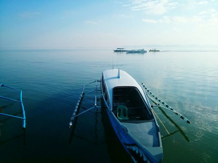 Boat on the shore in Pangasinan, Philippines. Water Sea Nautical Vessel Tranquility Outdoors Horizon Over Water No People Gondola - Traditional Boat ASIA Philippines Nature Reflection Ships Boat Boats Pangasinan Hundred Islands  Ocean Sea And Sky An Eye For Travel