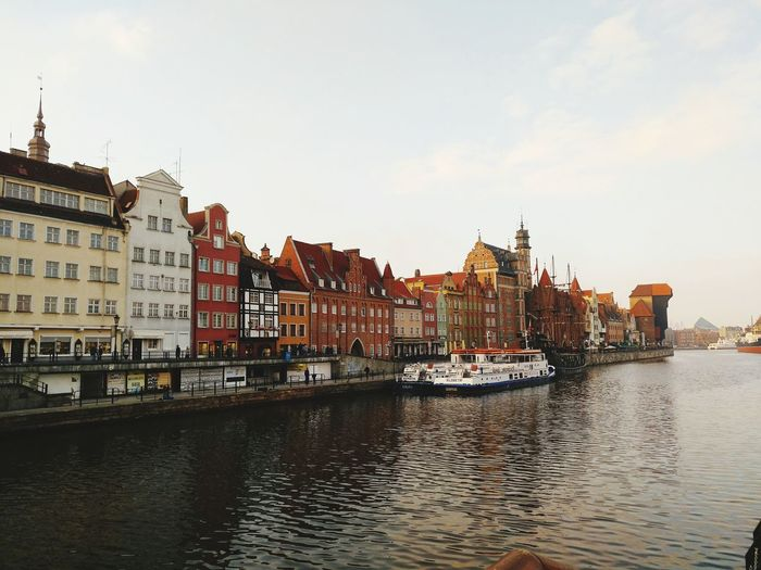 EyeEmNewHere EyeEm Selects Poland Gdansk, Poland River Riverside Reflection Street Canal Boat Building Exterior Architecture Built Structure History Travel Destinations No People Sea City Day Sky Cityscape Water Outdoors Business Finance And Industry