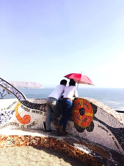 Two People Sea Water Lover Lovers Lima-Perú Lima Umbrella Umbrellas Couple Couple - Relationship Relationship Relationships Clear Sky Scenics View Ocean Ocean View