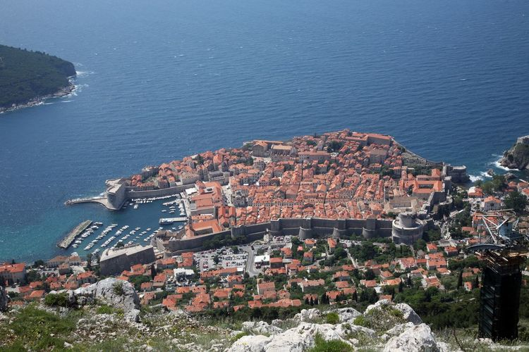 High angle view of townscape by sea