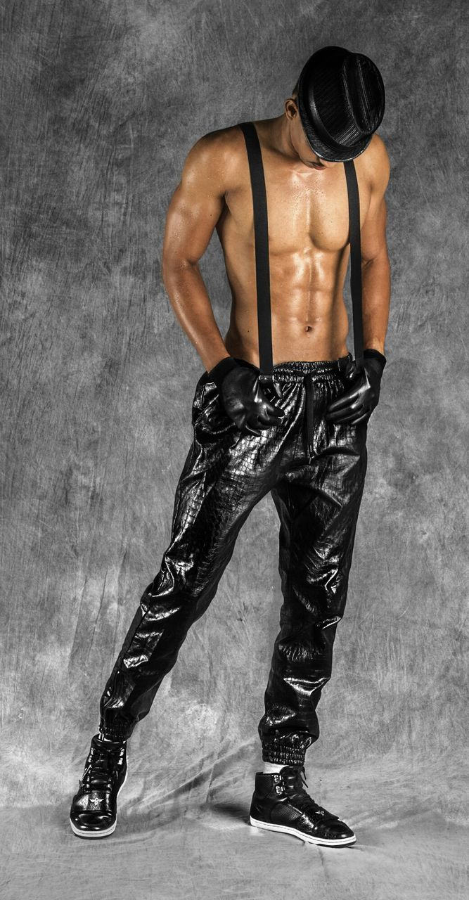 muscular build, exercising, black color, lifestyles, studio shot, the human body, healthy lifestyle, beautiful people, fashion, men, males, adult, fashion model, human body part, beauty, one person, full length, masculinity, young adult, one man only, people, adults only, indoors, athlete, only men