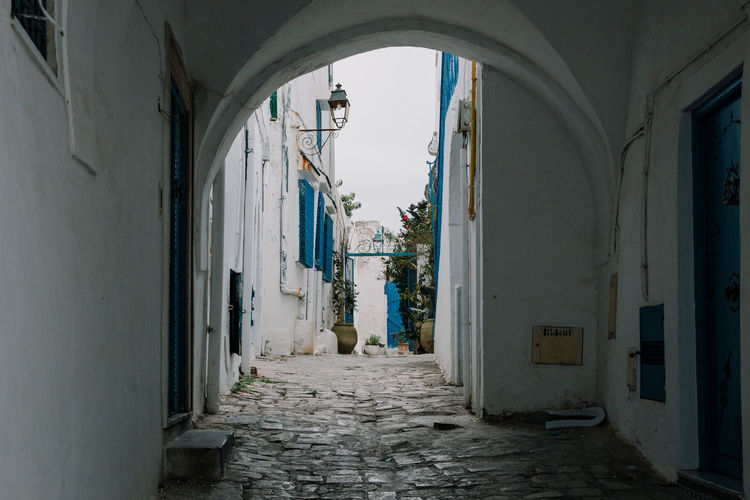 Archway amidst buildings in city