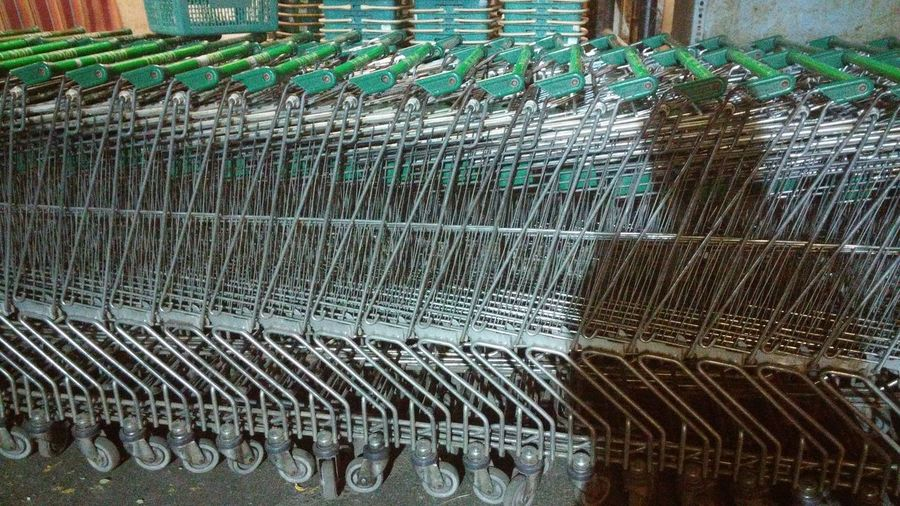 No People Outdoors Close-up Shopping Trolley Shadow Many Trolleys Train Of Trolley Steel Trolley Wheels Shopping Trolleys Group Of Steel Shopping Trolley